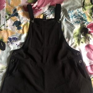 Black cropped overalls.